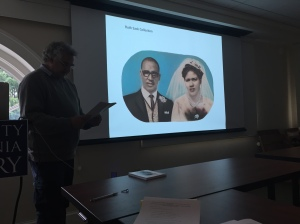 Paul Weinberg discussing a painted wedding portrait made from South African identity card photographs; May 21, 2015; photo by E. Lee Eltzroth