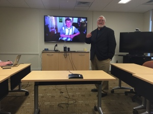 John Edwin Mason, University of Virginia, standing, and via Skype, Scott French, University of Central Florida; photo by E. Lee Eltzroth