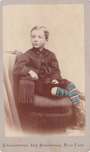 Hand-tinted Carte de visite by Chamberlin, 603 Broadway, New York, of an unidentified boy.