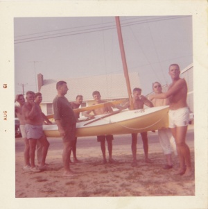 Friends with sailboat, Aug. 1961 color print